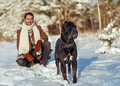 Man playing with his dog outdoors a in a winter forest cane corso Royalty Free Stock Photography