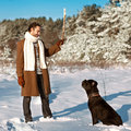 Man playing with his dog outdoors a in a winter forest cane corso Royalty Free Stock Images