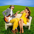 Man playing lovely song to the girl that don't like it Royalty Free Stock Photo