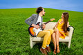 Man playing lovely song to the girl that like it on the couch Royalty Free Stock Photo