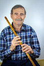Man playing on pipe flute traditional folk instruments of balkan europe Stock Image