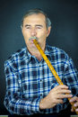 Man playing on pipe flute traditional folk instruments of macedonia europe Royalty Free Stock Images