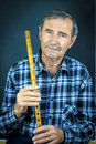 Man playing on pipe flute traditional folk instruments of macedonia europe Stock Photography