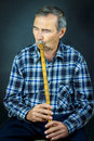 Man playing on pipe flute Royalty Free Stock Photo