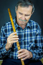 Man playing on pipe flute traditional folk instruments of macedonia europe Stock Image