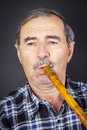 Man playing on pipe flute traditional folk instruments of macedonia europe Royalty Free Stock Photography