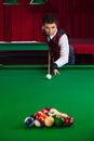 Man playing pool confident young in bow tie Royalty Free Stock Photos