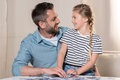 Man playing puzzle with daughter Royalty Free Stock Photo