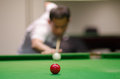 Man playing snooker a game Royalty Free Stock Images