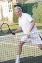 Man playing tennis and smiling Stock Photography