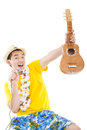 Man playing ukulele and singing happy Stock Images