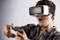 Man Playing Video Game Wearing Virtual Reality Headset Royalty Free Stock Photo