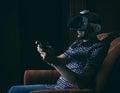 Man playing video games wearing virtual reality goggles Royalty Free Stock Photo