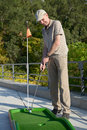 Man plays minigolf Stock Photography