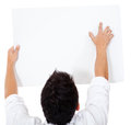 Man pointing at a banner Stock Image