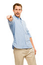 Man pointing casual happy white background potrait Royalty Free Stock Photo