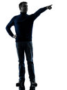 Man pointing finger silhouette full length one caucasian in studio isolated on white background Stock Photo