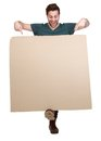 Man pointing fingers down to blank poster full length portrait of a smiling board on isolated white background Royalty Free Stock Image