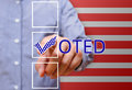 Man pointing tick mark, voting symbols ,presidential election