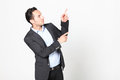 Man pointing to his left on white background Stock Photography