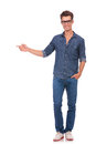 Man pointing to side & hand in pocket Royalty Free Stock Photo