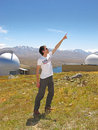 Man pointing to sky young in front of mount john observatory south island of new zealand it is new zealand s premier astronomical Stock Images