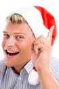 Man pointing up with christmas hat Royalty Free Stock Photo