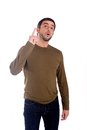 Man pointing up for copy space half length portrait of a to wearing a brown shirt and jeans on a white background Royalty Free Stock Image