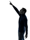 Man pointing up surprised silhouette full length Royalty Free Stock Photos