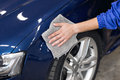 Man polishing cleaning car with microfiber cloth, detailing or valeting concept Royalty Free Stock Photo