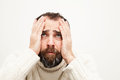 Man portrait upsen holding his head with hands Royalty Free Stock Photos