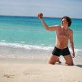 Man posing on beach Stock Image