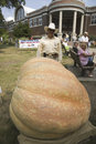 Man posing in front of giant squash winner, Royalty Free Stock Photo