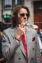 Man posing outside gucci fashion shows building for milan women s fashion week italy september poses on september in Stock Images