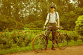 Man posing with retro bicycle in the park