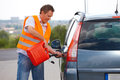 Man pouring fuel Royalty Free Stock Photo