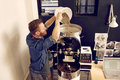 Man pouring raw coffee beans into a modern machine Royalty Free Stock Photo