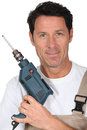 Man with power drill closeup smiling Stock Photos