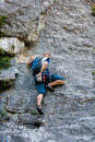 Man practices in climbing at the rock in the crimea mountains Royalty Free Stock Images