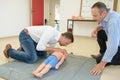 Man practicing resuscitation on child dummy Royalty Free Stock Photo