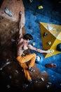 Man practicing rock climbing muscular on a wall indoors Royalty Free Stock Photos