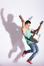Man practicing rock on electric guitar Stock Images