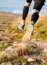 Man practicing trail running and leaping outdoors Royalty Free Stock Photo