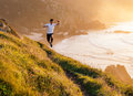 Man practicing trail running and leaping in a path in the coast sunny day Royalty Free Stock Image