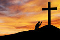 Man praying under the cross Stock Photography
