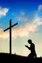 Man praying under the cross Royalty Free Stock Images