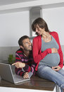 Man and pregnant woman doing online shopping happy young women with men Royalty Free Stock Image
