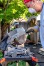 Man prepares a chop saw for cutting masonry Royalty Free Stock Photo