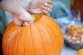 Man Prepares Halloween Pumpkin...