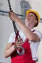 Man preparing crane hook to lifting materials Royalty Free Stock Photo